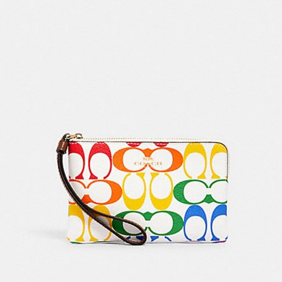 Coach Handbags - 🌈CORNER ZIP WRISTLET IN RAINBOW SIGNATURE CANVAS